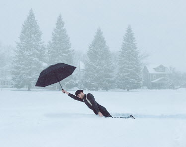 Logan Zillmer SURREAL MAN HOLDING UMBRELLA IN SNOW Men