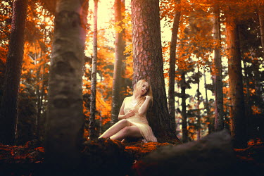 Anais Popy WOMAN SITTING ALONE IN AUTUMN FOREST Women