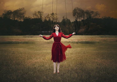 Lauren Alexandra Miller WOMAN IN FIELD WITH PUPPET STRINGS Women