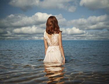 Lauren Alexandra Miller WOMAN WADING IN CALM RIPPLED WATER Women