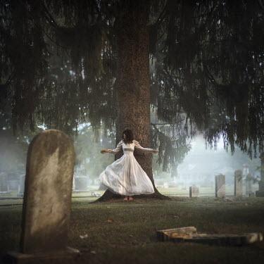 Lauren Alexandra Miller WOMAN BESIDE TREE IN GRAVEYARD Women