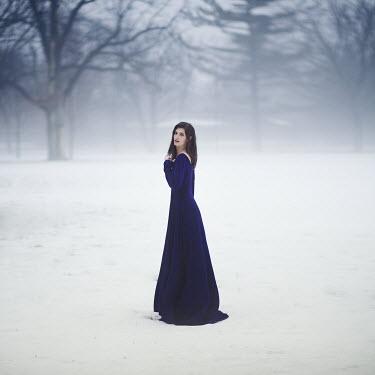 Lauren Alexandra Miller WOMAN IN LONG DRESS STANDING IN SNOWSCAPE Women