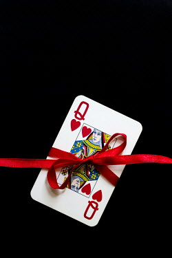 Trevor Payne PLAYING CARD TIED WITH RED RIBBON Miscellaneous Objects