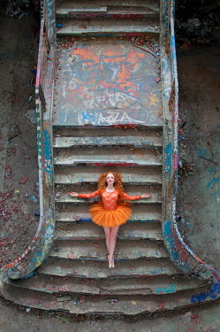 Rebecca Knowles BALLERINA LYING ON STEPS FROM ABOVE Women