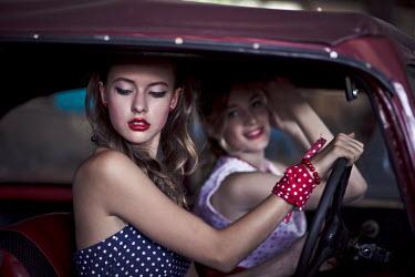 Ildiko Neer TWO RETRO WOMEN SITTING IN CAR Groups/Crowds