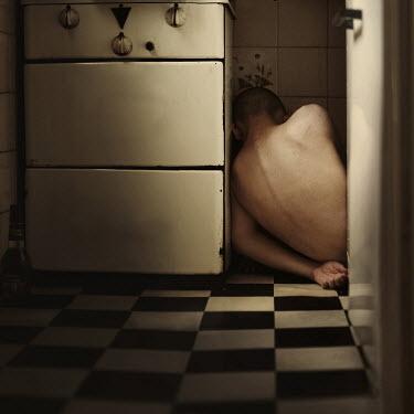Marko Nadj MANS CORPSE BESIDE COOKER IN KITCHEN Men