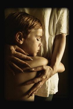 Katerina Lomonosov YOUNG BOY BEING HUGGED INSIDE Children