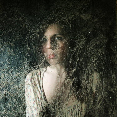 Katerina Lomonosov DARK HAIRED WOMAN BEHIND DIRTY WINDOW Women