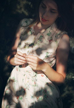 Mark Owen YOUNG WOMAN LYING IN SHADE OUTSIDE Women