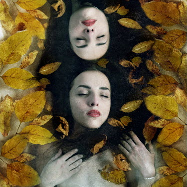 Katerina Lomonosov TWO WOMEN WITH EYES CLOSED AMONG LEAVES Groups/Crowds