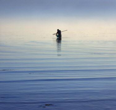 Adrian Leslie Campfield MAN FISHING IN CALM SEA WATER Men