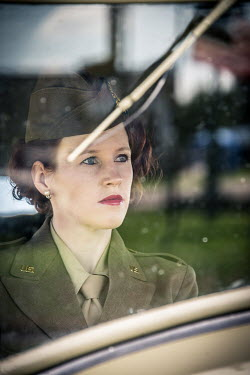 Elisabeth Ansley RETRO WOMAN WEARING UNIFORM IN CAR Women