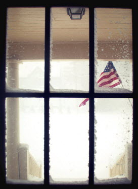 Jude McConkey SNOWY WINDOW WITH AMERICAN FLAG OUTSIDE Building Detail