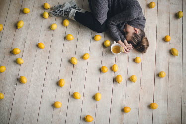 Dasha Pears WOMAN LYING BESIDE CUP AND LEMONS INSIDE Women