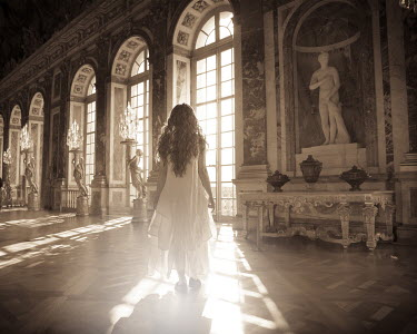 Patty Maher WOMAN INSIDE ORNATE ROOM WITH STATUES Women
