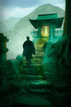 James Wragg SILHOUETTE OF ASIAN MAN ON STEPS OUTSIDE Men