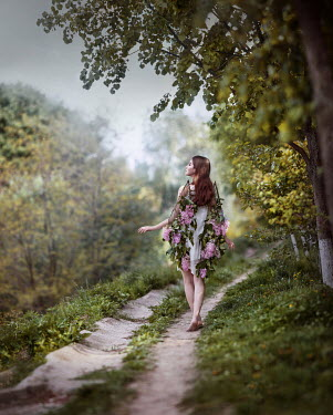 Irina Dzhul WOMAN WITH FLORAL WINGS ON COUNTRY PATH Women