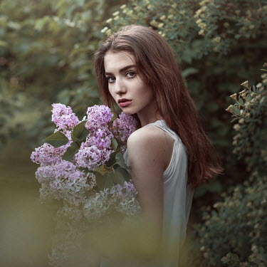 Irina Dzhul YOUNG BRUNETTE WOMAN WITH FLOWERS OUTSIDE Women
