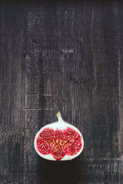 Maren Becker SLICE OF FIG ON WOODEN SURFACE Miscellaneous Objects