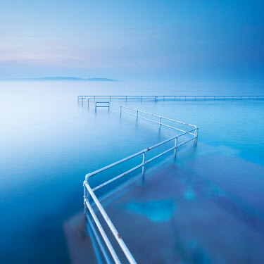 Tony Worobiec METAL RAILINGS IN CALM BLUE SEASCAPE Seascapes/Beaches