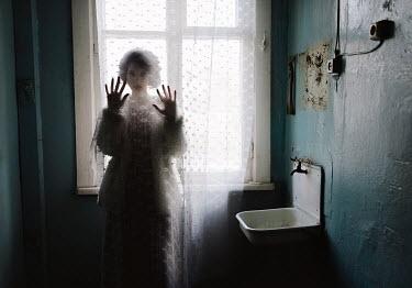 Igor Burba SPOOKY WOMAN BEHIND CURTAIN IN SHABBY ROOM Women