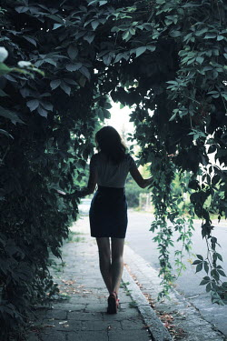 Wojciech Zwolinski WOMAN STANDING UNDER BUSH ON STREET Women