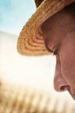 Nicola Smith CLOSE UP OF MAN IN STRAW HAT OUTSIDE Men