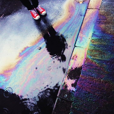 Felicia Simion MAN REFLECTED IN RAINBOW OIL SPILL OUTSIDE Men