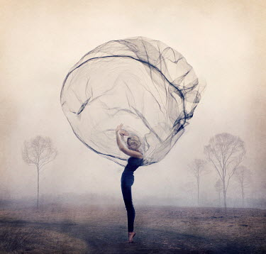 Kylli Sparre WOMAN WITH BILLOWING FABRIC IN COUNTRYSIDE Women
