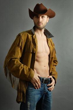 Jon Downie MUSCULAR MAN IN COWBOY HAT INDOORS Men