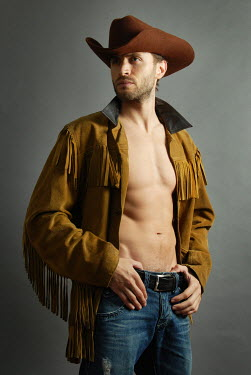 Jon Downie MUSCULAR MAN WEARING COWBOY HAT INDOORS Men