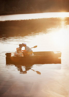 Nikaa COUPLE KISSING IN ROWING BOAT ON LAKE Couples