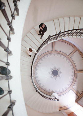 Nikaa COUPLE ON SPIRAL STAIRCASE FROM ABOVE Couples