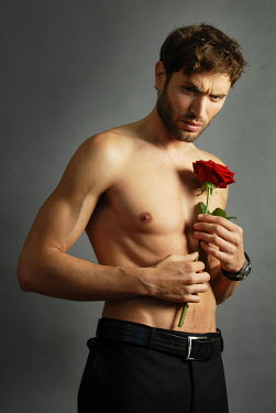 Jon Downie MUSCULAR MAN WITH BARE CHEST HOLDING ROSE Men