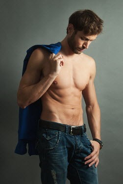 Jon Downie MUSCULAR MAN WITH BARE CHEST HOLDING SHIRT Men