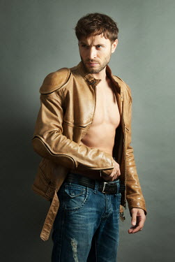 Jon Downie MUSCULAR MAN WITH BARE CHEST AND LEATHER JACKET Men