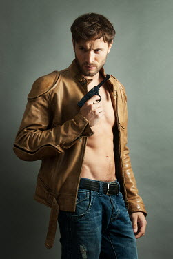 Jon Downie MUSCULAR MAN WITH LEATHER JACKET AND GUN Men
