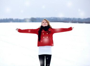 Rekha Garton WOMAN IN RED COAT IN SNOWY COUNTRYSIDE Women