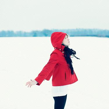 Rekha Garton WOMAN IN RED HOOD IN SNOWY COUNTRYSIDE Women