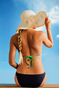 Vanessa Paxton WOMAN IN BIKINI AND SUN HAT OUTSIDE Women