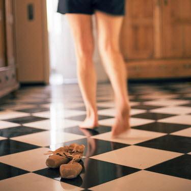 Carmen Spitznagel WOMAN LEAVING BALLET SHOES ON FLOOR INDOORS Women