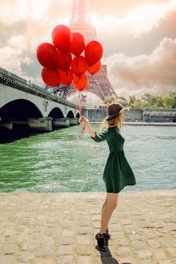 Elisabeth Ansley WOMAN HOLDING BALLOONS NEAR EIFFEL TOWER Women