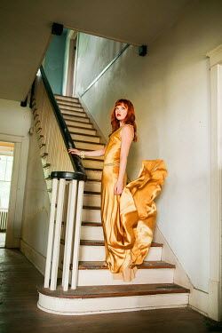 Rachel Nichole RETRO WOMAN IN YELLOW DRESS ON STAIRS Women