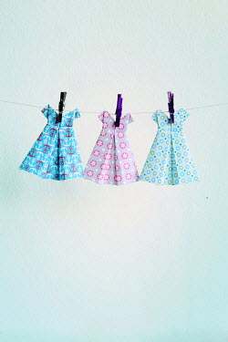 Jasenka Arbanas PAPER DRESSES ON WASHING LINE INDOORS Miscellaneous Objects