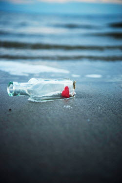 Karina Simonsen RED HEART IN BOTTLE LYING ON BEACH Miscellaneous Objects