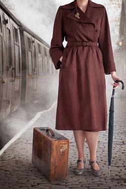 Lee Avison 1940S WOMAN WITH SUITCASE NEAR TRAIN Women