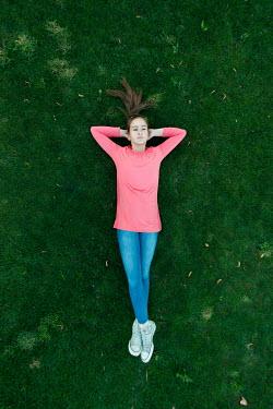 ILINA SIMEONOVA YOUNG WOMAN LYING ON GRASS FROM ABOVE Women