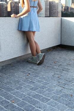 ILINA SIMEONOVA YOUNG WOMAN LEANING ON CITY WALL Women