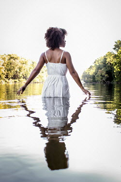Stephen Carroll YOUNG BLACK WOMAN WADING IN LAKE Women