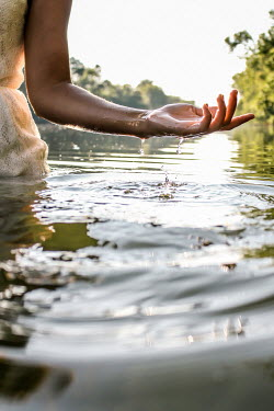 Stephen Carroll CLOSE UP OF WOMANS ARM SPLASHING IN LAKE Women